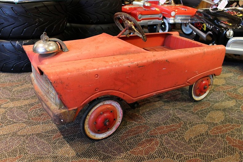 An original red car with firebell