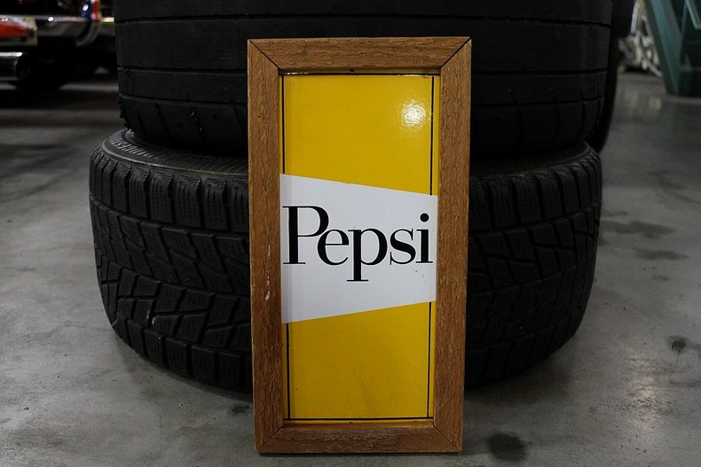 Small yellow pepsi sign