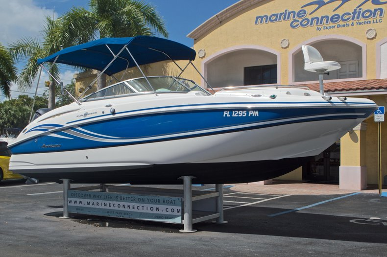 Thumbnail 1 for Used 2013 Hurricane SunDeck SD 2400 OB boat for sale in West Palm Beach, FL