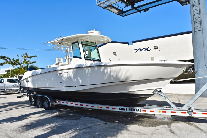 Thumbnail 1 for Used 2013 Boston Whaler 320 Outrage boat for sale in Fort Lauderdale, FL