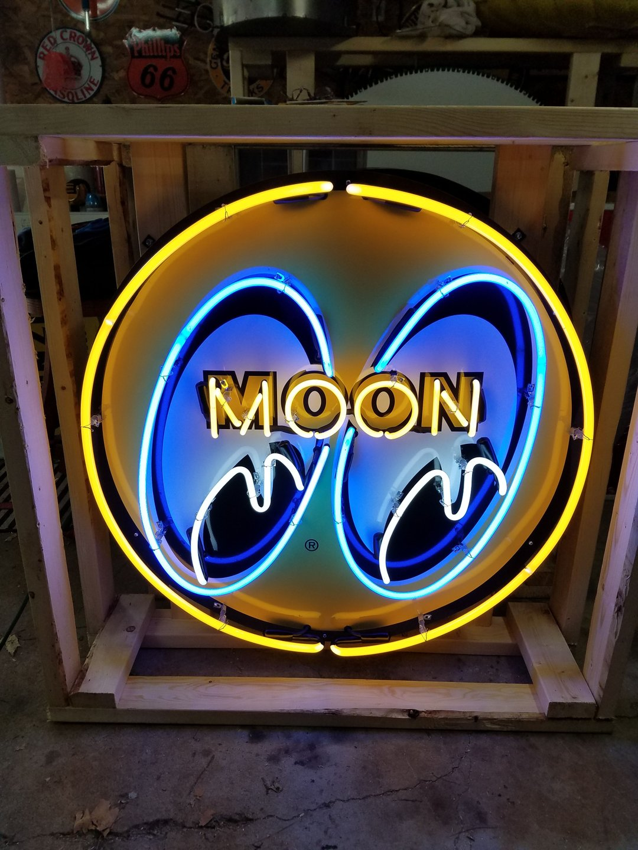 Moon eyes tin neon sign