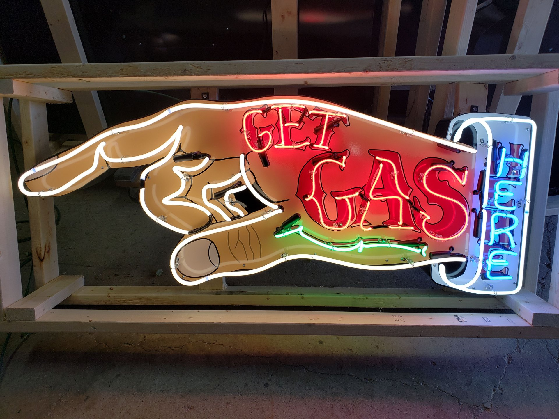Get gas here tin neon sign