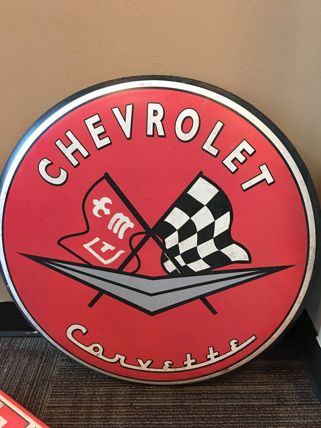 Chevrolet corvette button sign