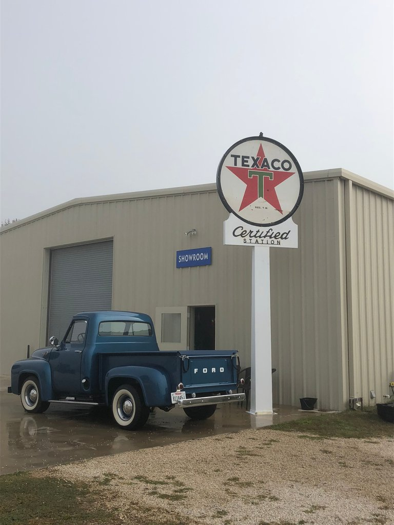 6 foot round Vintage Texaco sign mounted in the 18 foot sign and pole