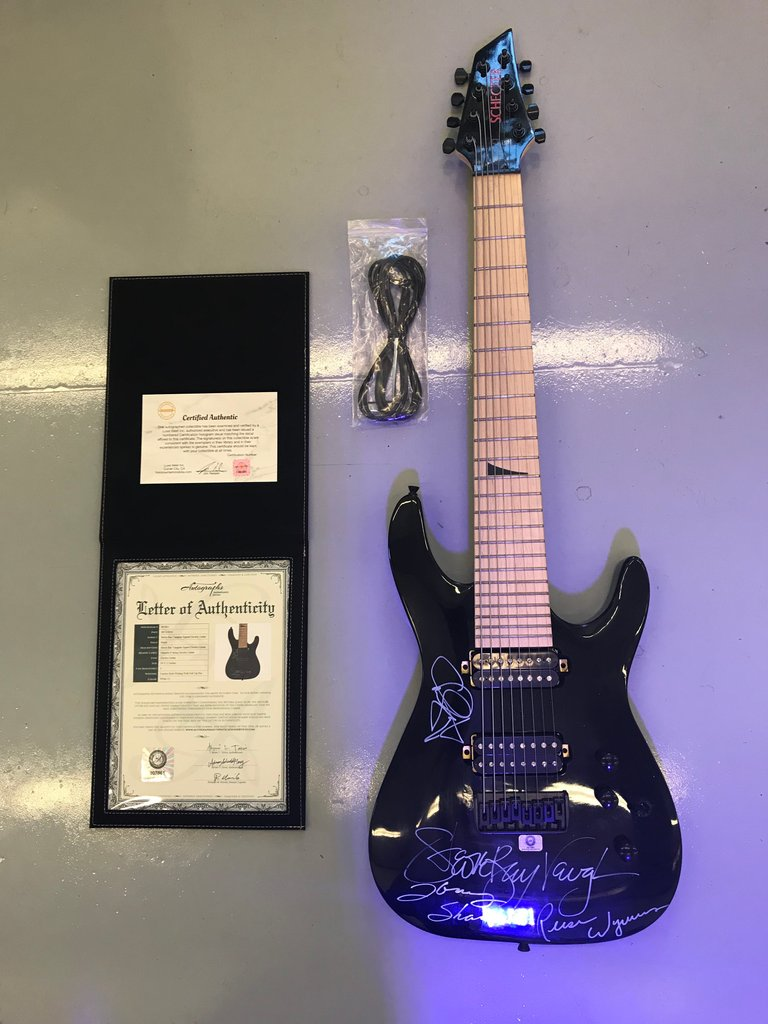 STEVIE RAY VAUGHAN & DOUBLE TROUBLE AUTOGRAPHED GUITAR WITH C.O.A.
