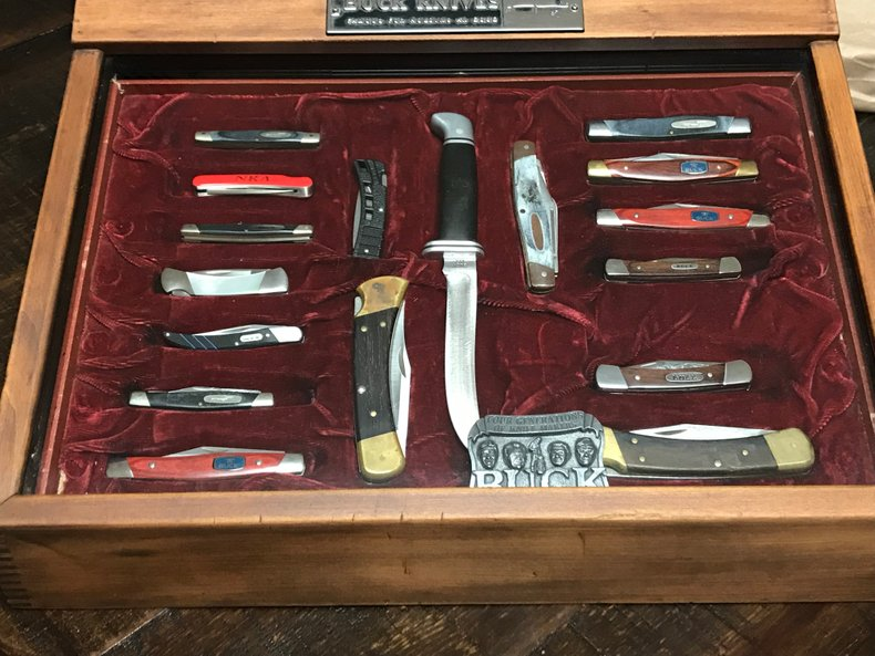 Buck knife collection with super nice display case.