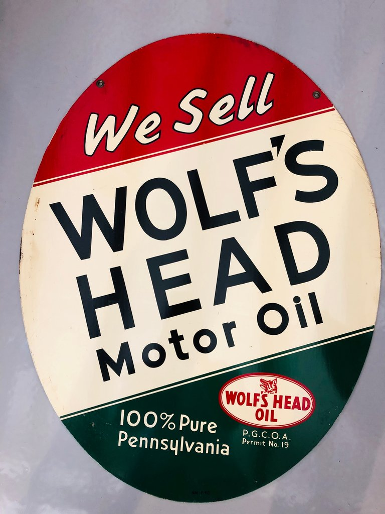 RARE 1940 ORIGINAL DOUBLE SIDED OVAL WOLF'S HEAD OIL