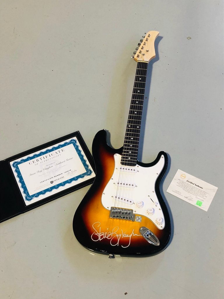 Autographed Stevie Ray Vaughan electric guitar with certificate of authenticity.