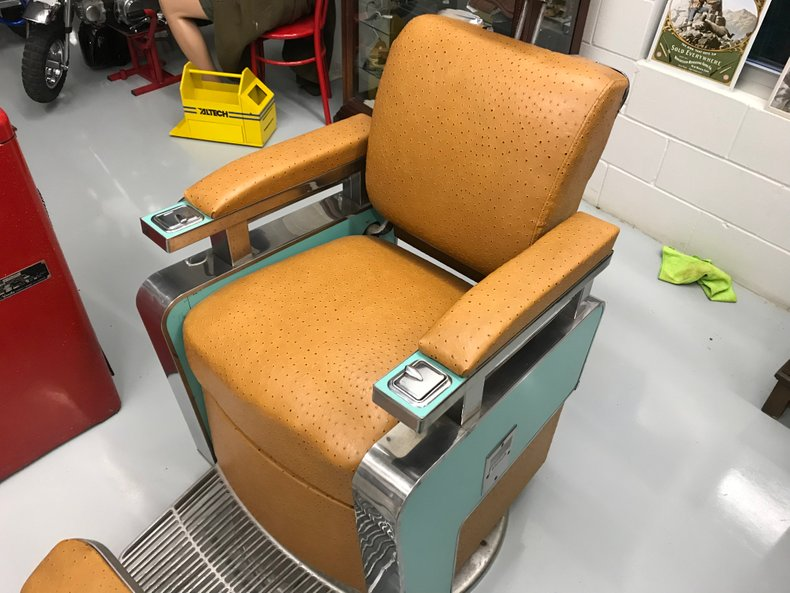 Refurbished vintage Barber Chair Ostrich interior and turqoise
