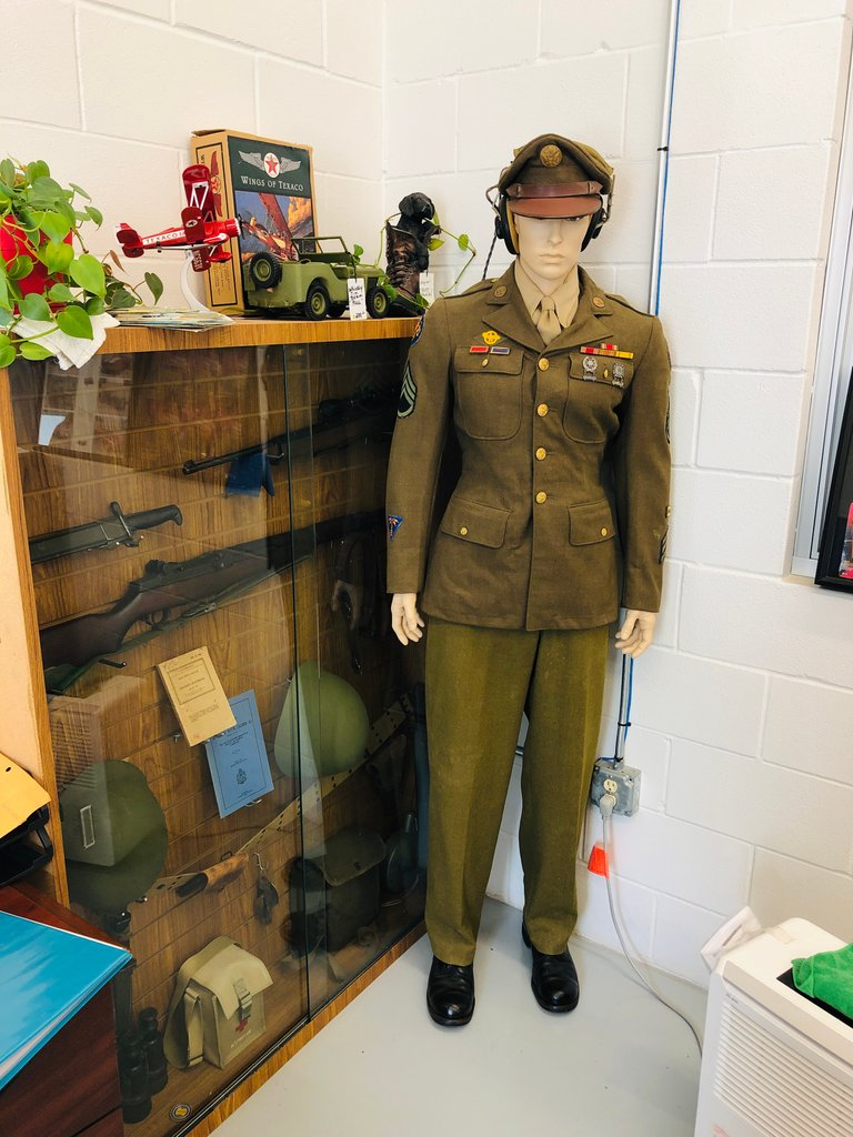 Original WWII uniform, headphones all on a display mannequin
