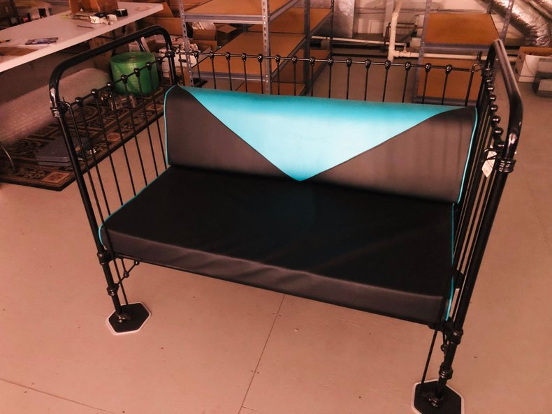 Restored 20's metal bed as 50's couch